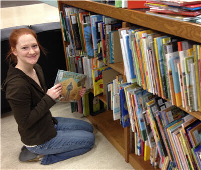 Education librarian Jill Morningstar with children's books just added to the MSU collection.